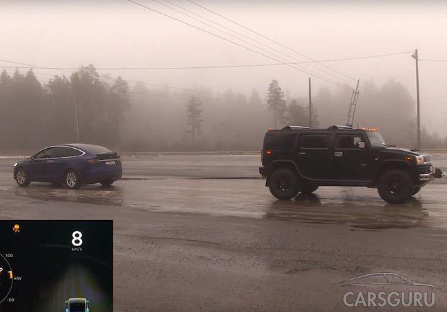 Испытание в перетягивании каната: Tesla Model X vs. Hummer H2